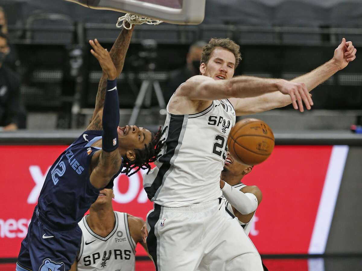 SAN ANTONIO, TX - FEBRUARY 01: Jakob Poeltl #25 of the San Antonio Spurs blocks shot of Ja Morant #12 of the Memphis Grizzlies at AT&T Center on February 1, 2021 in San Antonio, Texas. NOTE TO USER: User expressly acknowledges and agrees that , by downloading and or using this photograph, User is consenting to the terms and conditions of the Getty Images License Agreement. (Photo by Ronald Cortes/Getty Images)