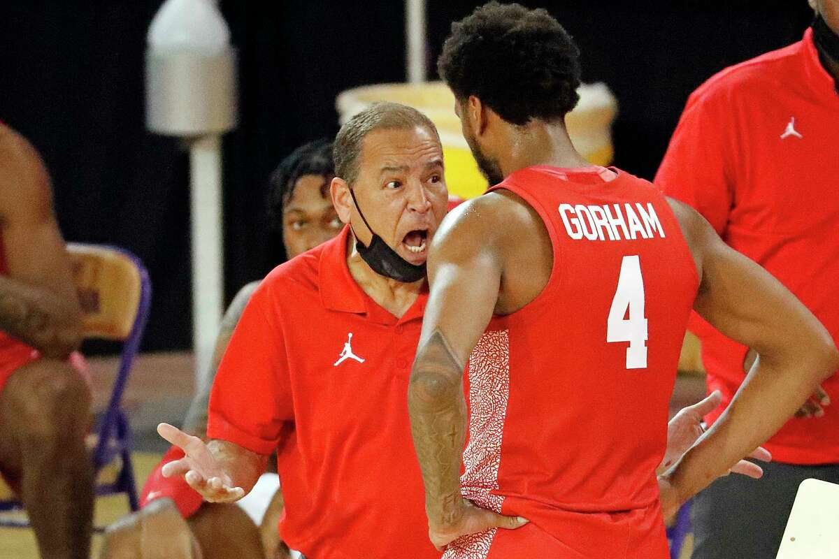 Houston head coach Kevin Sampson speaks with Houston's Justin Gorham (4) during the second half of an NCAA college basketball game against East Carolina in Greenville, N.C., Wednesday, Feb. 3, 2021. (AP Photo/Karl B DeBlaker)