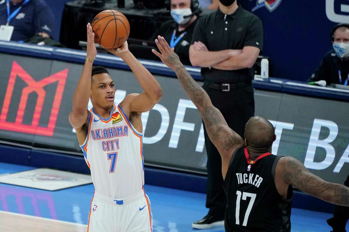 Oklahoma City Thunder forward Darius Bazley (7) shoots over Houston Rockets forward P.J. Tucker (17) in the first half of an NBA basketball game Wednesday, Feb. 3, 2021, in Oklahoma City. (AP Photo/Sue Ogrocki)