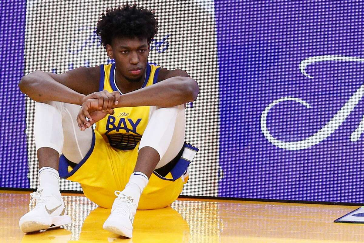 Golden State Warriors center James Wiseman (33) holds his wrist as he waits to be substituted into the NBA game against the Detroit Pistons at Chase Center on Saturday, Jan. 30, 2021, in San Francisco, Calif. The rookie has a sprained left wrist, after finishing a lob pass from Draymond Green and landing on the floor, and will be re-evaluated in 7-10 days, the Warriors announced Monday afternoon.