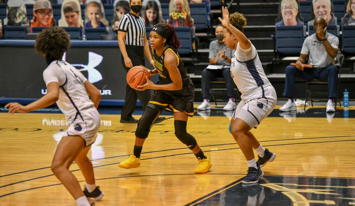 Isis Young, center, said she and her Siena teammates have managed to shake off the many pauses this season by joking about it. (Courtesy of Monmouth Athletics)