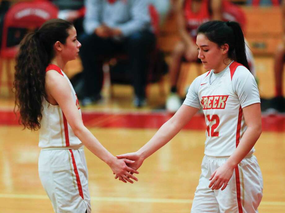 FILE PHOTO — Caney Creek's Olivia Hernandez (12) gets a high-five from Brooklynn Beaza (15) after drawing a foul during the second quarter of a District 20-5A high school basketball game at Caney Creek High School, Wednesday, Jan. 27, 2021, in Grangerland. Photo: Jason Fochtman, Houston Chronicle / Staff Photographer / 2021 © Houston Chronicle