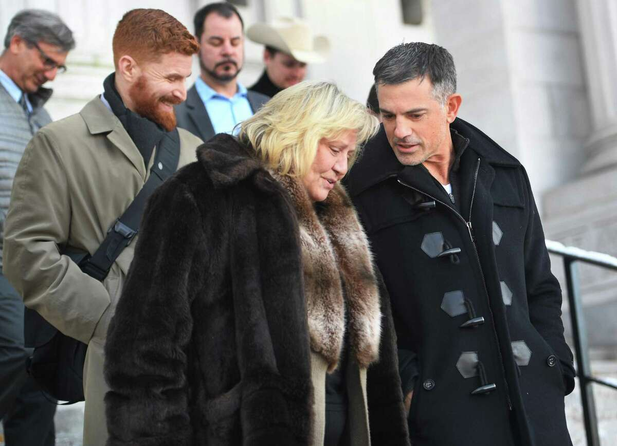Fotis Dulos exits the Connecticut State Supreme Court with his sister, Rena Dulos Kyrimi, on Thursday, December 12, 2019.