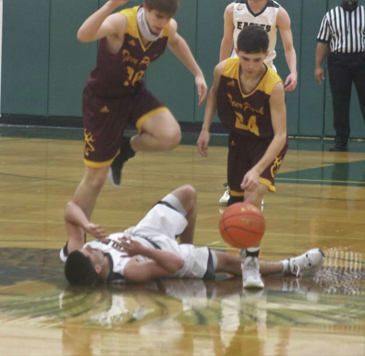 Deer Park's Garrett Topping and Andrew Aguilar try to avoid Pasadena's Kanye Ortiz after Ortiz was fouled with 1:28 remaining in Wednesday night's game and the Eagles up 42-36.