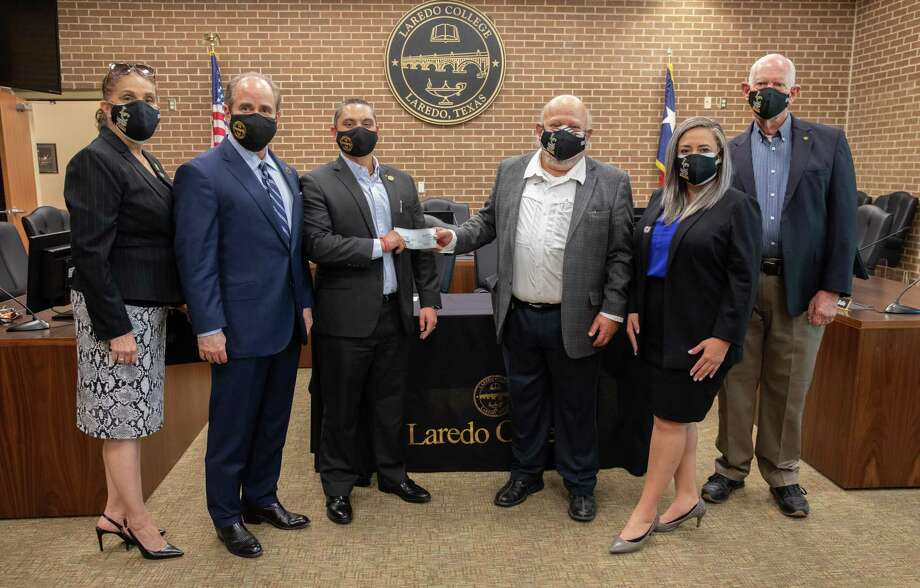 Members of the Laredo Rotary Charitable Foundation, Inc. arrived at Laredo College Wednesday as a total of $8,000 in scholarships between the two was donated for qualifying students. Photo: Courtesy / Laredo College