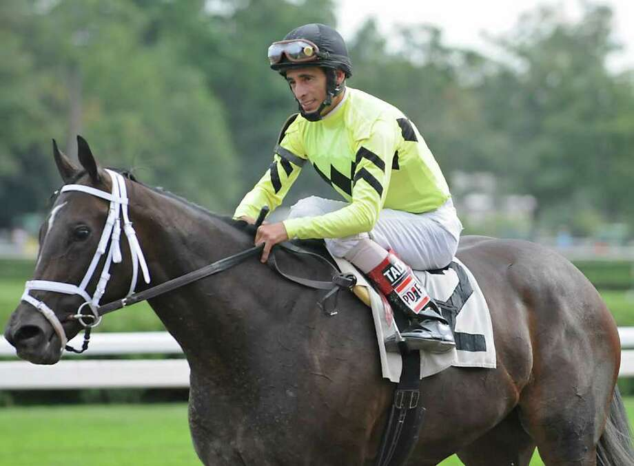 Jockey John Velazquez rides back to the winner's circle on Street Mate after the seventh race during the last day of the racing season at Saratoga Race Course on Monday.  Velazquez didn't win this race, but was honored after Monday?s sixth race for winning the Saratoga riding title. (Lori Van Buren / Times Union) Photo: Lori Van Buren