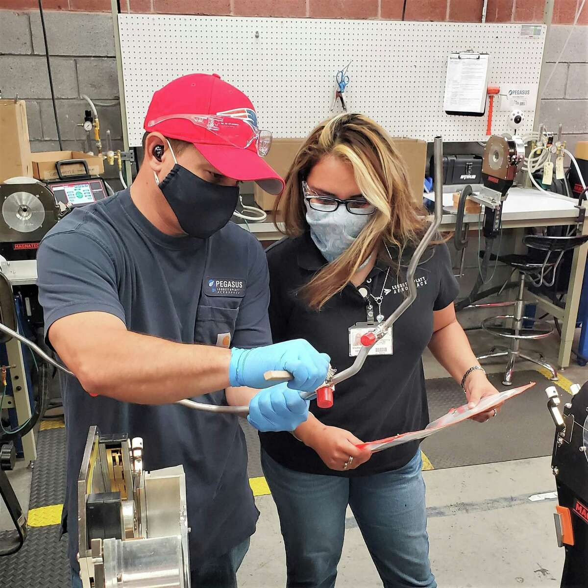 Middlesex Community College student Liz Moag, right, is shown at Pegasus Manufacturing in Middletown. The school recently received $12,500 in grants from the Gene Haas Foundation, which will be awarded to precision manufacturing students.