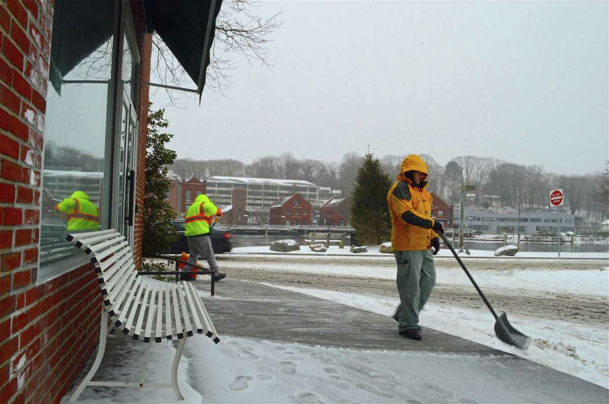 Workers clear Parker-Harding Plaza on Tuesday, Feb. 12, 2019, in Westport, Conn. Improvements to Longshore, Baron's South and Parker Harding Plaza were listed as three big projects to undertake in the capital plan, as well as a continued investment in infrastructure.