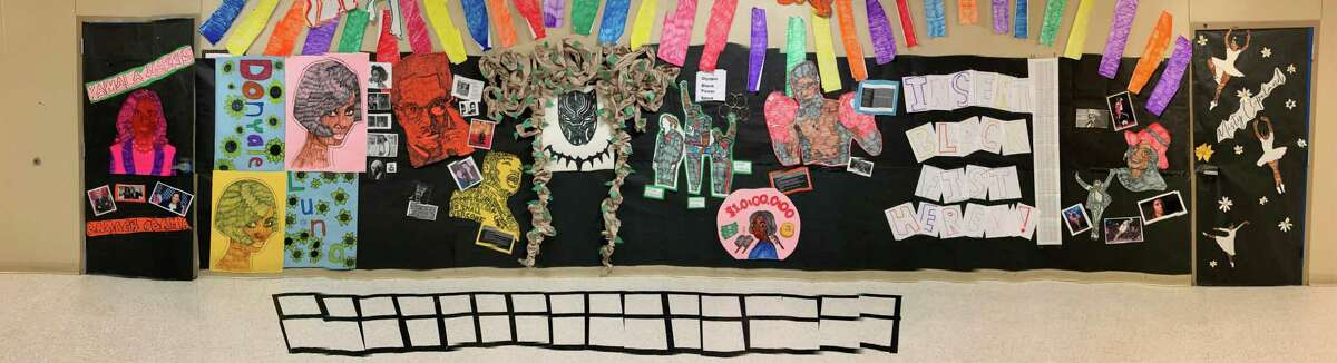 """""""Insert Black Fist Here!"""" takes the place of a portion of a Black History Month display at Vincent Middle School that was taken down at the request of an anonymous complaint about the """"political nature of the message"""" according to Mikelle Patillo, the long-term substitute who worked with students on designing the wall."""