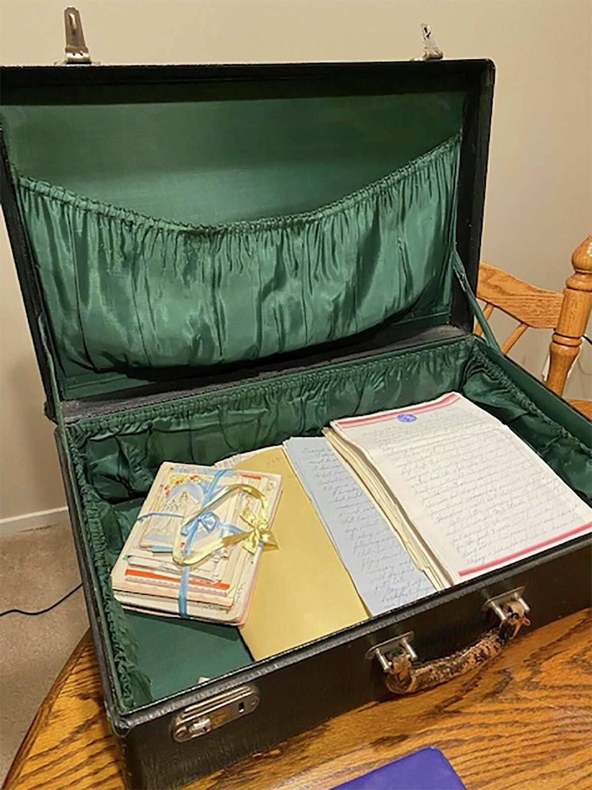 Abattered suitcase,circa 1940s,that sat inan attic for decades contained letters written byJoseph Brakorato his future wife, Helen, and vice versa, during in World War II.(Courtesy photo/Cathy Johnson)