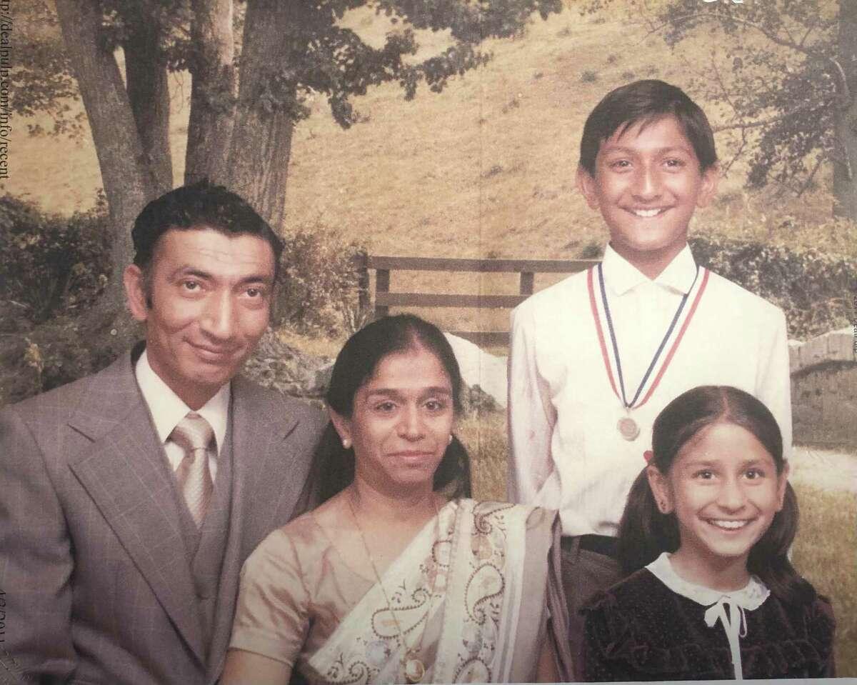 Shabbir Mohsin Hamdani, left, posed with his family in 1983.