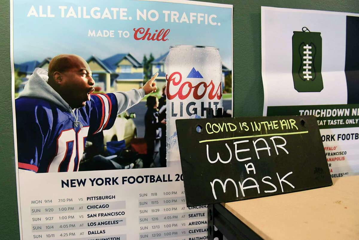 A sign to remind patrons to wear a mask is seen at an Albany bar on Thursday, Feb. 4, 2021. Warren County on Feb. 10, 2021 said it is contact tracing people for coronavirus who attended two Super Bowl parties. (Lori Van Buren/Times Union)