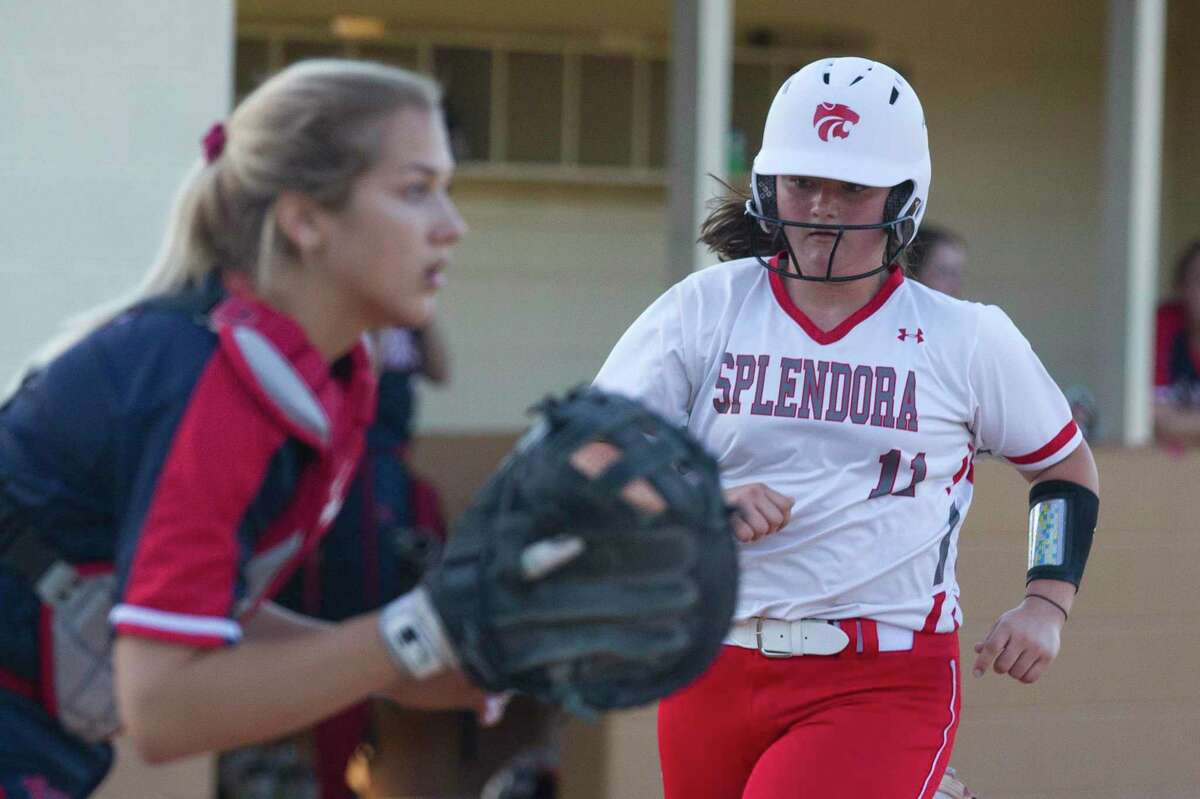 Leah Hensarling #11 of Splendora scores on a RBI single by Taylor Jordan in the second inning of a Region III-4A high school softball bi-district playoff game, Friday, April 26, 2019, in Splendora.