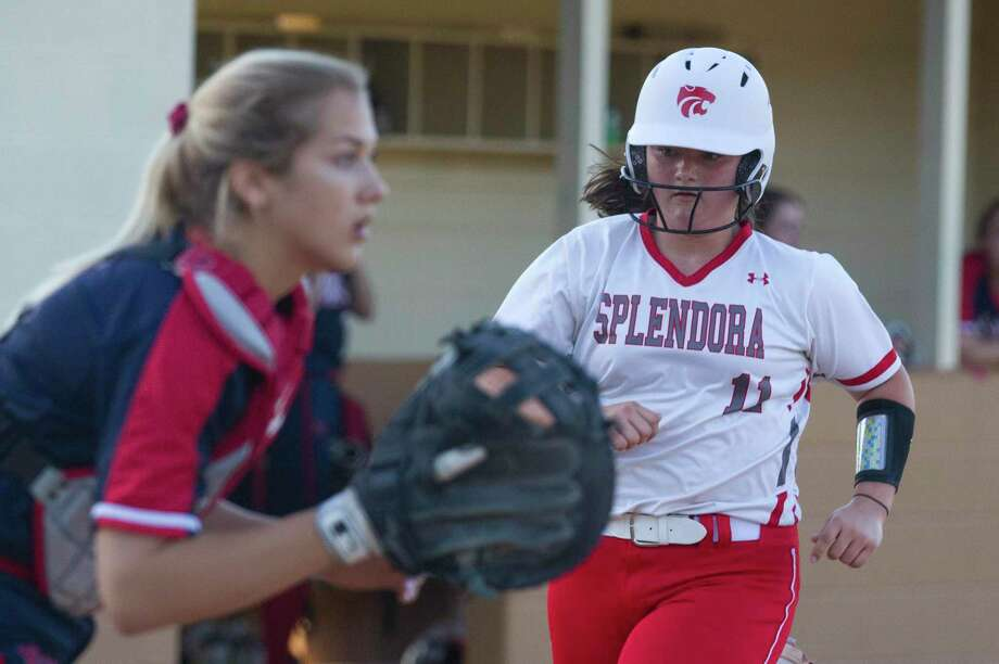 Leah Hensarling #11 of Splendora scores on a RBI single by Taylor Jordan in the second inning of a Region III-4A high school softball bi-district playoff game, Friday, April 26, 2019, in Splendora. Photo: Jason Fochtman, Houston Chronicle / Staff Photographer / © 2019 Houston Chronicle