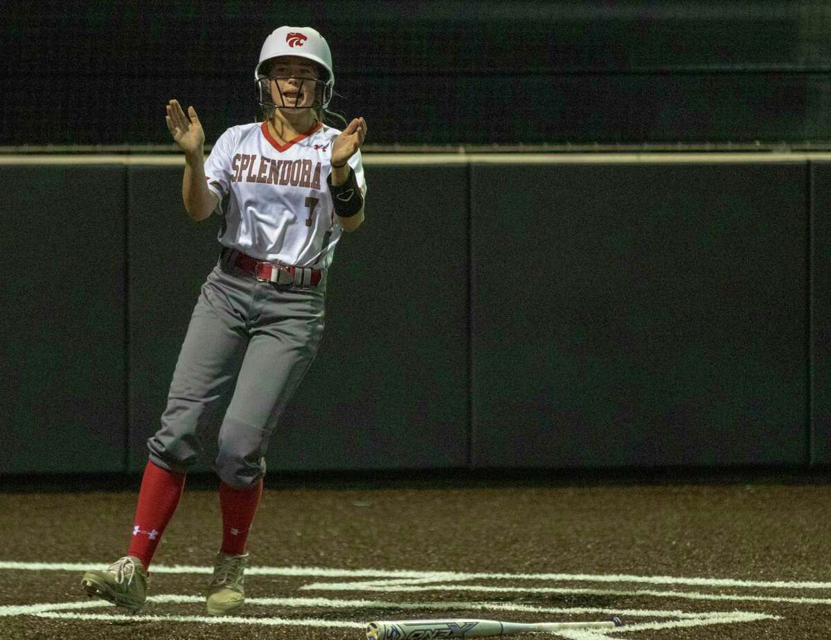 Splendora substitute runner Honor Knott (7) claps her hands after crossing home plate during a Region III-4A quarterfinal softball game at Humble High School in Humble.