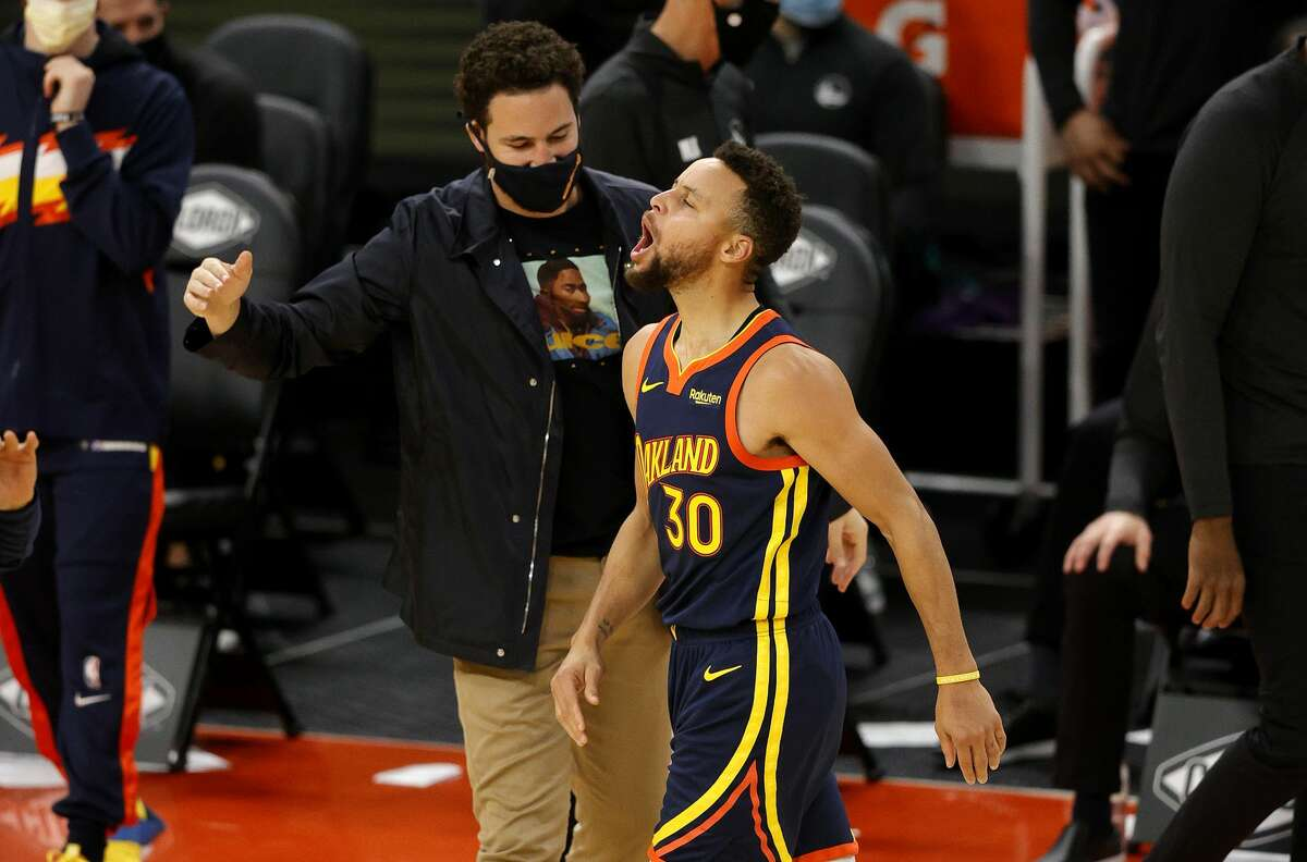 Stephen Curry of the Golden State Warriors celebrates with Klay Thompson after he made a three-point basket in the fourth quarter against the Minnesota Timberwolves.