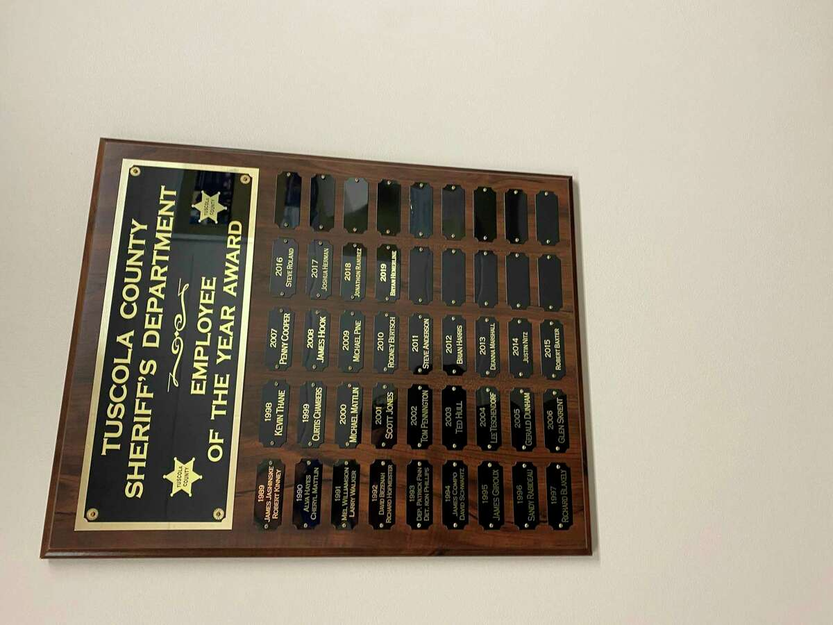 The Tuscola County Sheriff's Office employee of the year plaque, which recognizes every officer who faced new challenges throughout the year, will hang next to the individual officer of the year awards, which will most likely continue with next years award. (Courtesy Photo)