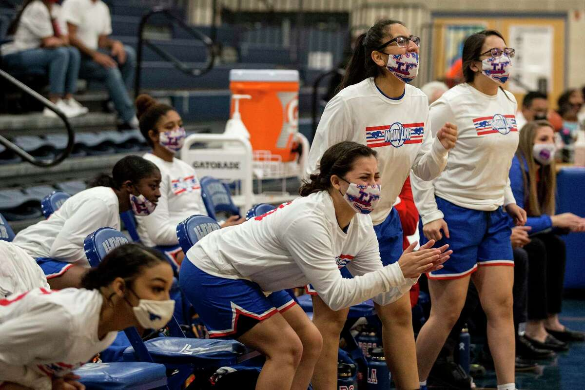 Jefferson players cheer their teammates onto victory against Sam Houston on Feb. 2. The win against Sam Houston gave Jefferson their first district championship in the school's history.