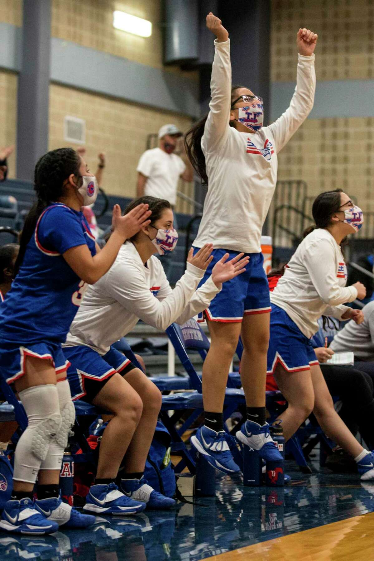 Jefferson players cheer their teammates onto victory against Sam Houston Tuesday, February 2, 2021. The win against Sam Houston gave Jefferson their first district championship in the school's history.