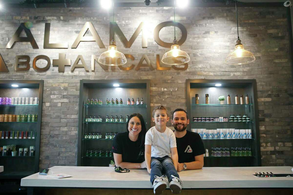 David and Nancy Burrow, both 34, pose with their son, Carter, 6, at the Alamo Botanicals location off Huebner Road, Tuesday, Feb. 2, 2021. The business started in 2017 with the Stone Oak location and has since opened three other locations, including one in New Braunfels.
