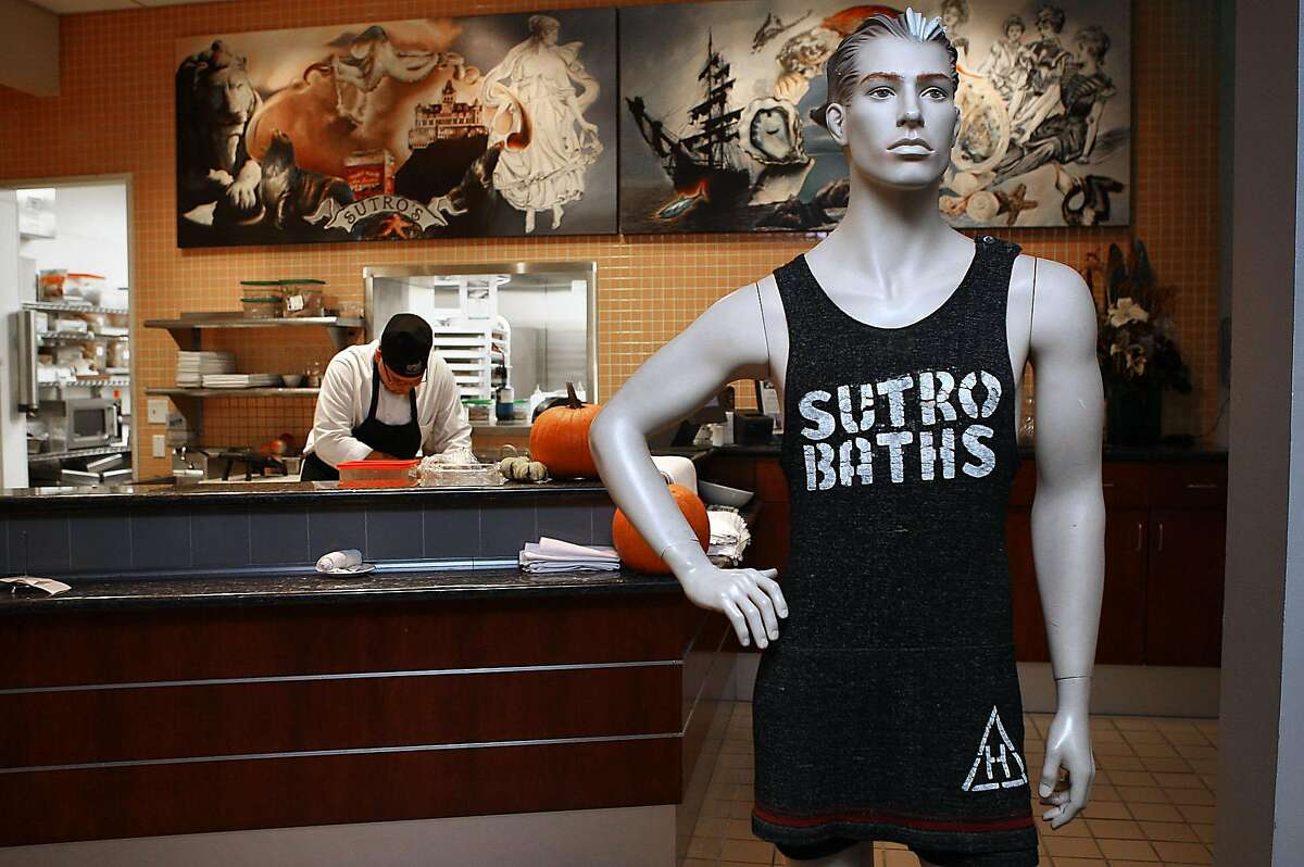 A mannequin wearing a sutro bathing suit as garde manger Carlos Sandhu-Gonzalez (left) makes croutons at Sutro's in the Cliff house in San Francisco, Calif., on Thursday, November 10, 2011. The bathing suit along with numerous other items stolen from the shuttered restaurant were recently recovered following a burglary.