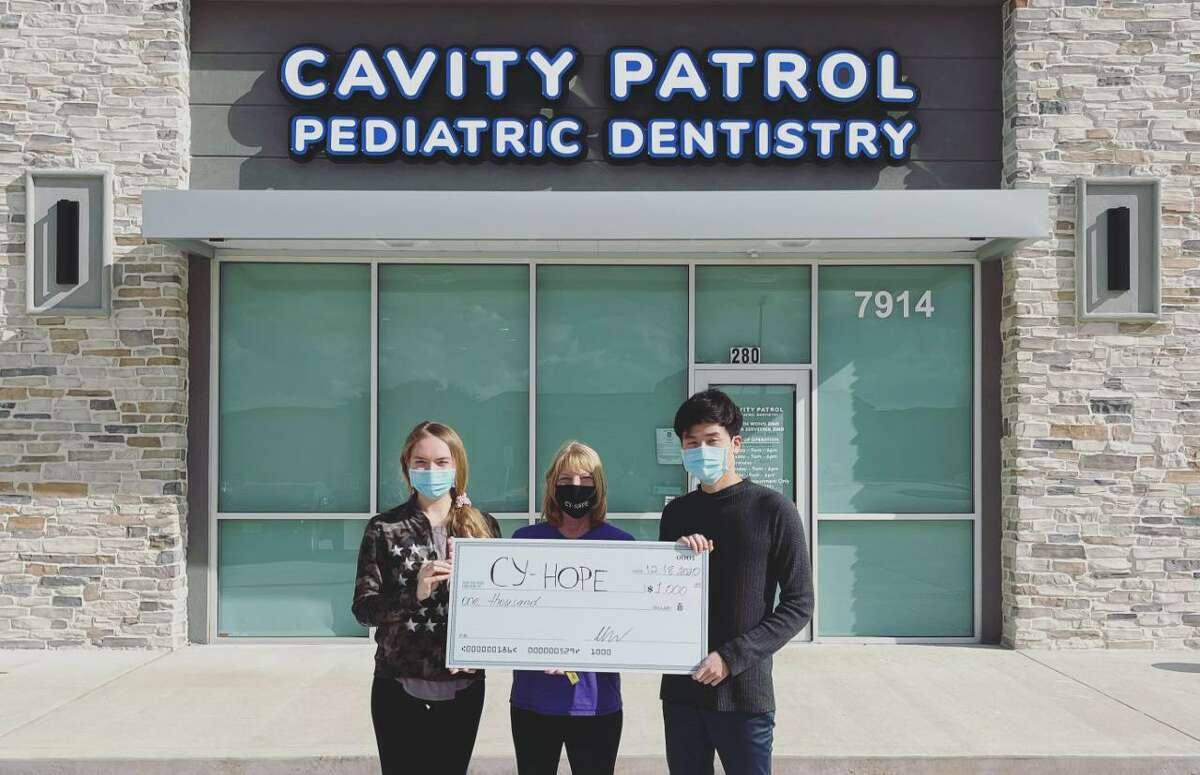 Cavity Patrol owners and dentists Julia Servetnik and Chun-Yin Wong have donated their first $1,000 check to Cy-Hope in an effort to help the nonprofit aid low-income Cy-Fair ISD students.