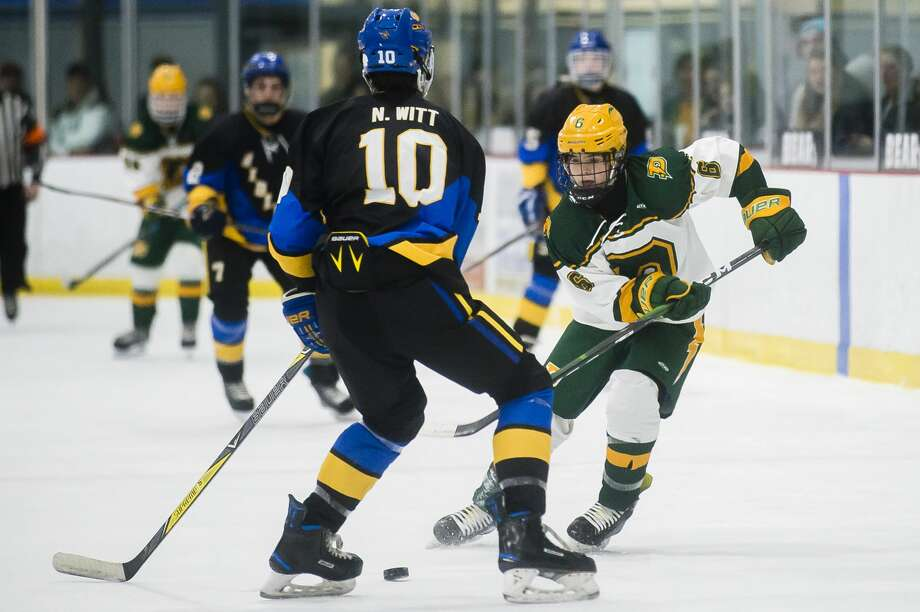Dow High's Nolan Sanders carries the puck up the ice during a Jan. 29, 2020 game against Midland High. Photo: Daily News File Photo