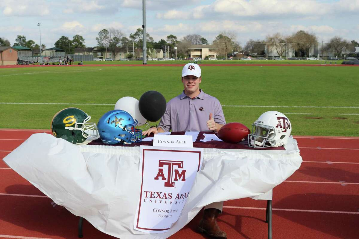 Stratford's Connor Able celebrates signing his National Letter of Intent to play football at Texas A&M University during a ceremony at the school on the afternoon of Feb. 3 for National Signing Day