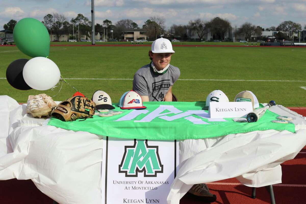 Stratford's Keegan Lynn celebrates signing his National Letter of Intent to play baseball at the University of Arkansas at Monticello during a ceremony at the school on the afternoon of Feb. 3 for National Signing Day