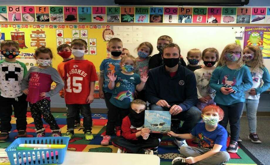 Tyler Bader, the USA Elementary School principal, with some of his kindergarten students. The district started the PASS program to help students who have fallen behind on their work or are at risk of failing. (Courtesy Photo/USA Schools)