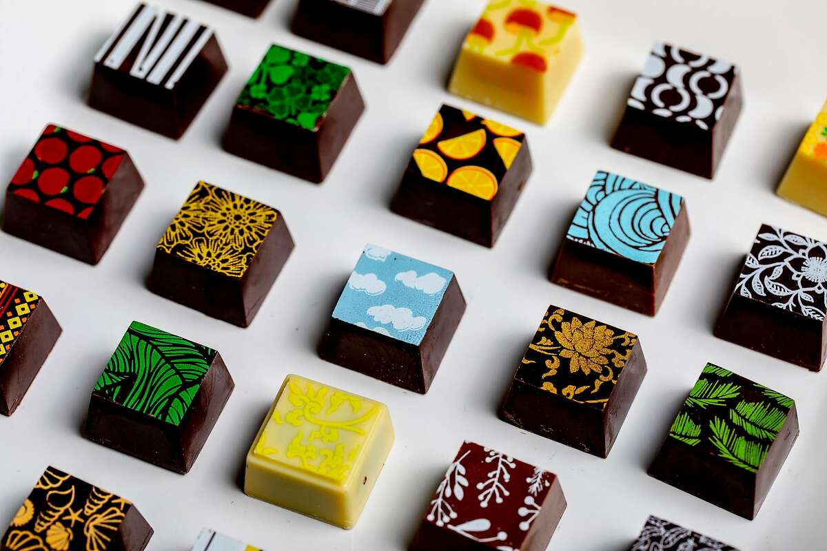 Kokak Chocolates sells chocolate bon bons with ornate patterns in San Francisco.