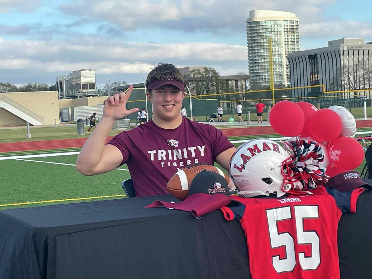 Lamar's Max Shilstone celebrates signing his National Letter of Intent to play football at Trinity University in a National Signing Day ceremony held at the school on the afternoon of Feb. 3