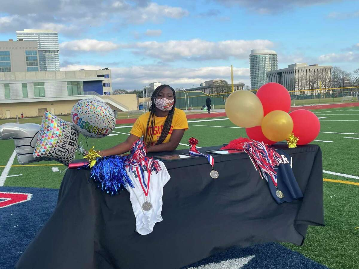 Lamar's Ja'Nyah Jenkins celebrates signing her National Letter of Intent for track and field at Tuskegee University in a National Signing Day ceremony held at the school on the afternoon of Feb. 3
