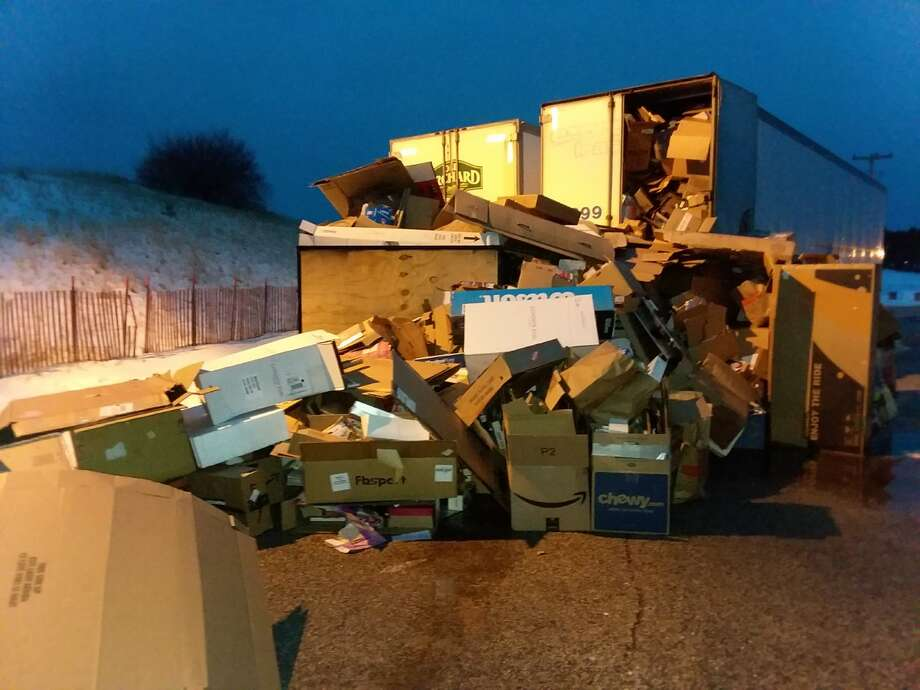 Cardboard spilled out of the recycling trailer at Manistee Central Catholic on Jan. 2, after the holidays. Photo: Michelle Graves/Manistee News Advocate
