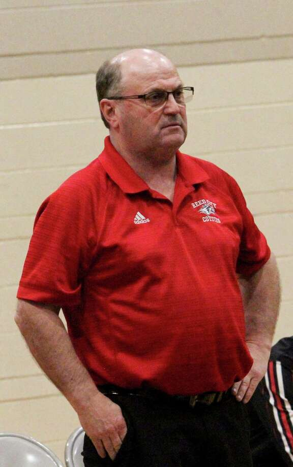 Reed City wrestling coach takes in the action during the 2018-19 season. (Pioneer file photo)