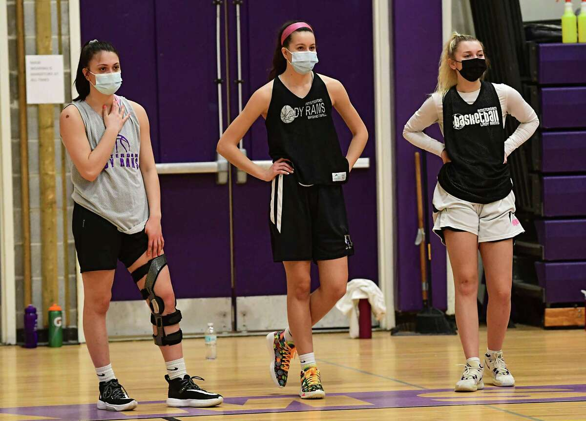 From left, Amsterdam seniors Jackie Stanavich, who signed to play with Mercy College, Antonia May, who signed to play with UMBC, and Andie Gannon, who signed to play with Roberts Wesleyan College, are seen watching a group run a drill during basketball practice on Thursday, Feb. 4, 2021 in Amsterdam, N.Y. (Lori Van Buren/Times Union)