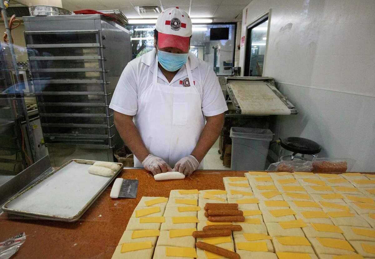 Shipley's Do-Nuts Baker Antonio Hernandez makes kolache Monday, Jan. 11, 2021, in Houston. The Paycheck Protection Program is rolling out its second round. In it, small business owners such as Alan Bergeron, who owns two Shipley's franchises, will be able to apply for a second loan starting Wednesday.