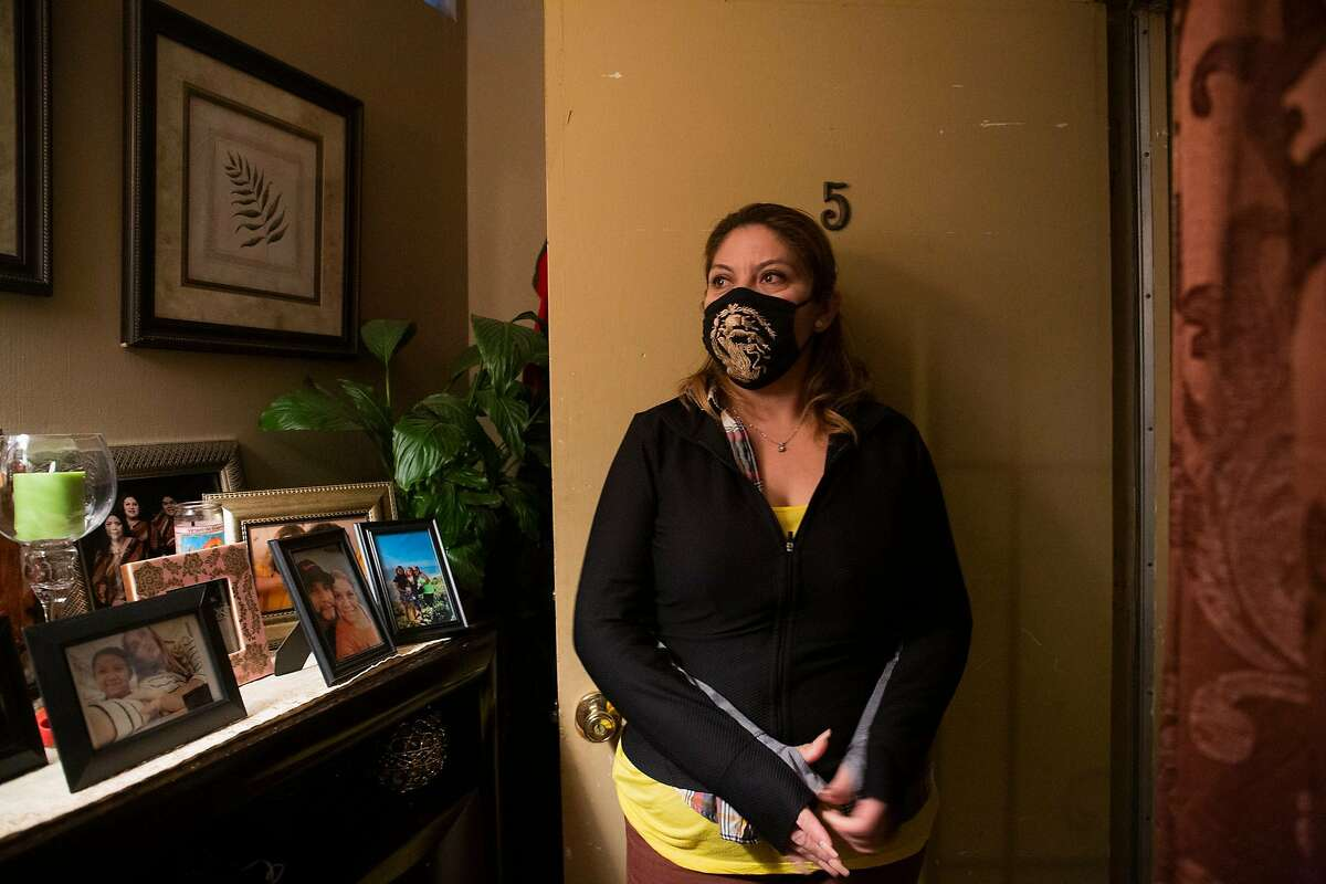 Angelica Rivas stands next to her apartment door in Oakland on Janurary 19, 2021.