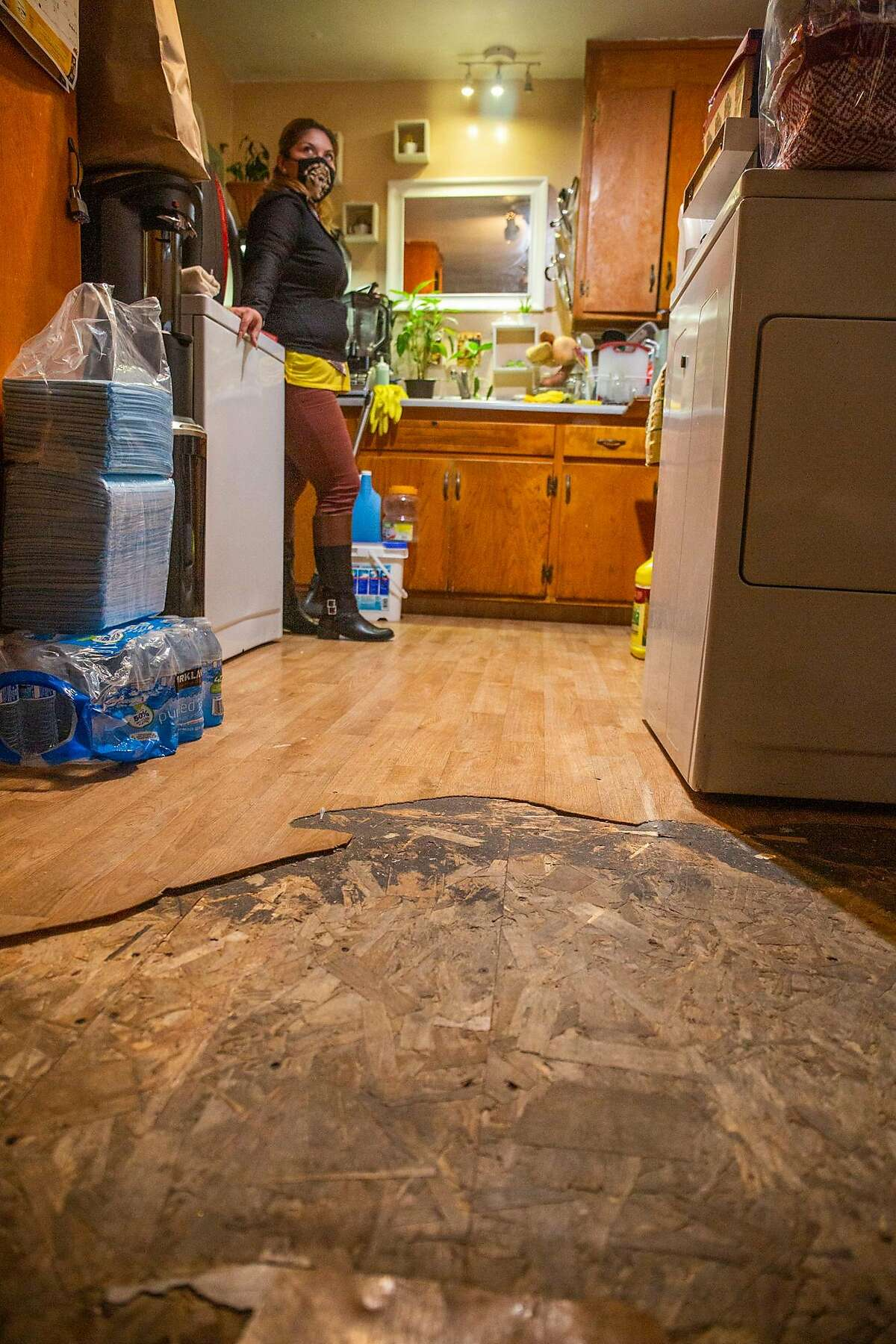 Angelica Rivas has been in her Oakland Apartment for over 16 years, her parents live next door and she lives with her three children. She has complained to the many landlords who have cycled through property ownership of the floor, the lack of light, the lack of water pressure, the cockroaches, and the rats.