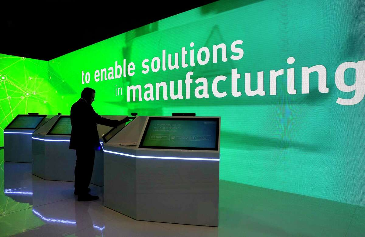 CERAWeek by IHS Markit was canceled in 2020 and will be held online in 2021. A conference attendant uses the touch screen displays and next to moving lit walls highlighting technologies in the Saudi Aramco room at the George R. Brown Convention Center on Tuesday, March. 12, 2019.