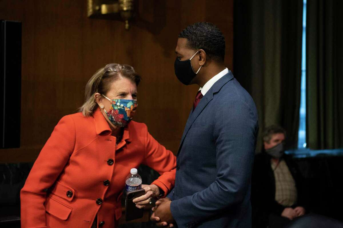 Sen. Shelley Moore Capito, R-W.Va., speaks with Administrator of the Environmental Protection Agency nominee Michael Regan after his confirmation hearing before the Senate Environment and Public Works committee on Capitol Hill in Washington, Wednesday, Feb. 3, 2021.