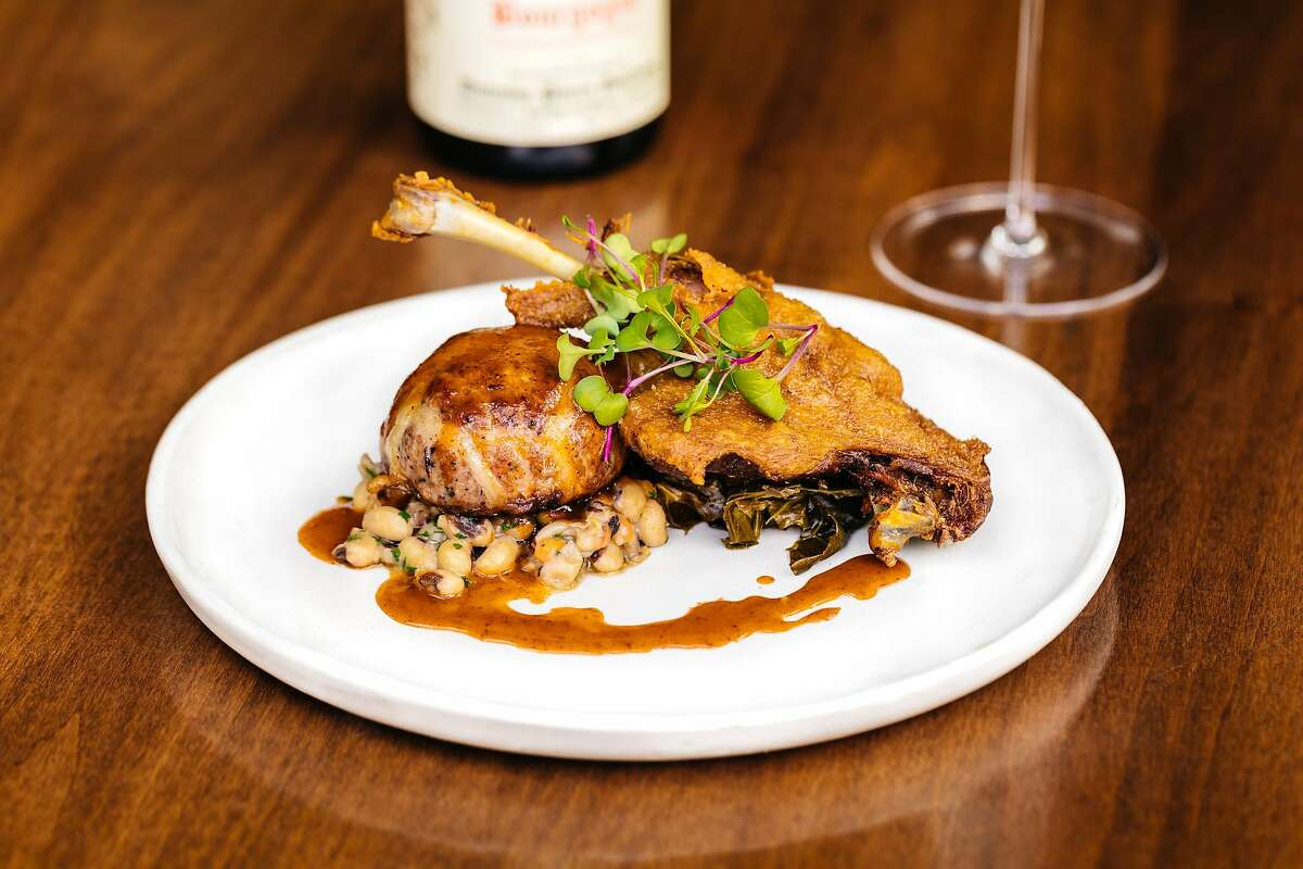 Liberty Duck Two Ways from Napa wine bar Compline comes with confit leg and crépinette with pickled collard greens, black eyed peas and duck jus.