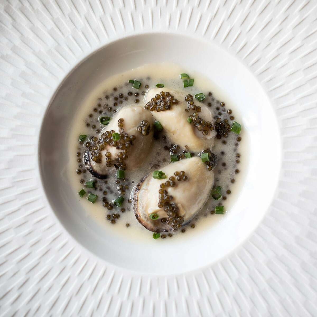 Butter-poached oysters with caviar and Champagne from San Francisco's Acquerello.