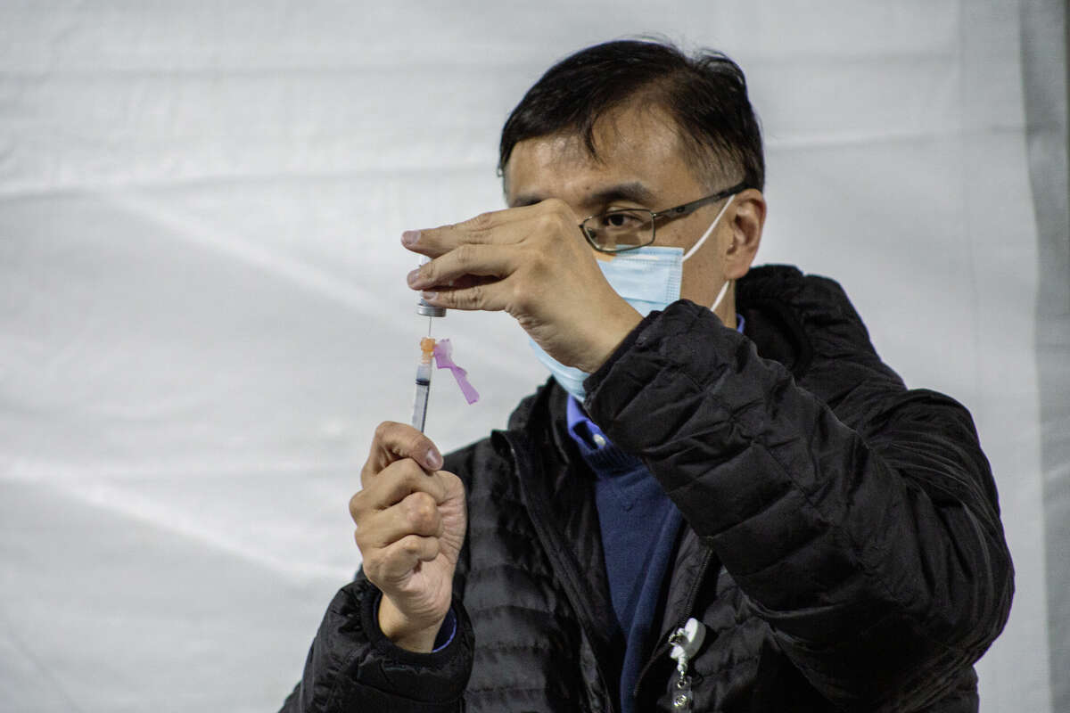 Washington residents get their coronavirus vaccines through Swedish's mobile vaccination clinic set up in Federal Way.