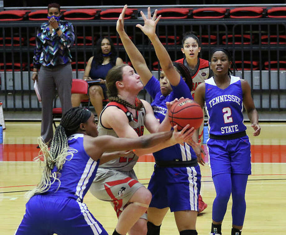 SIUE's Allie Troeckler (middle) is fouled by Tennessee State's 3 on a drive through the lane in the first half on Thursday at First Community Arena in Edwardsville. Photo: Greg Shashack / The Telegraph