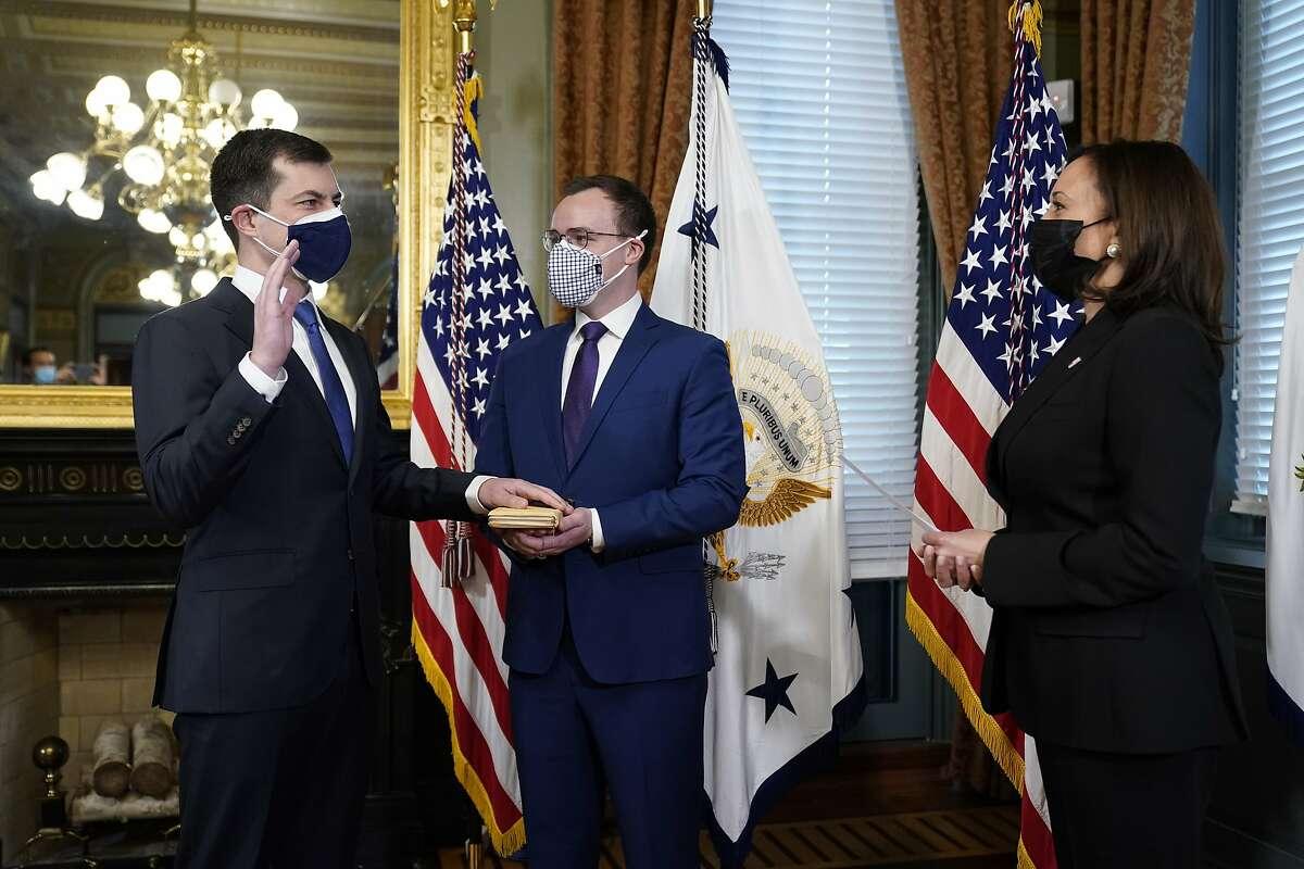 Pete Buttigieg is sworn in by Vice President Kamala Harris.