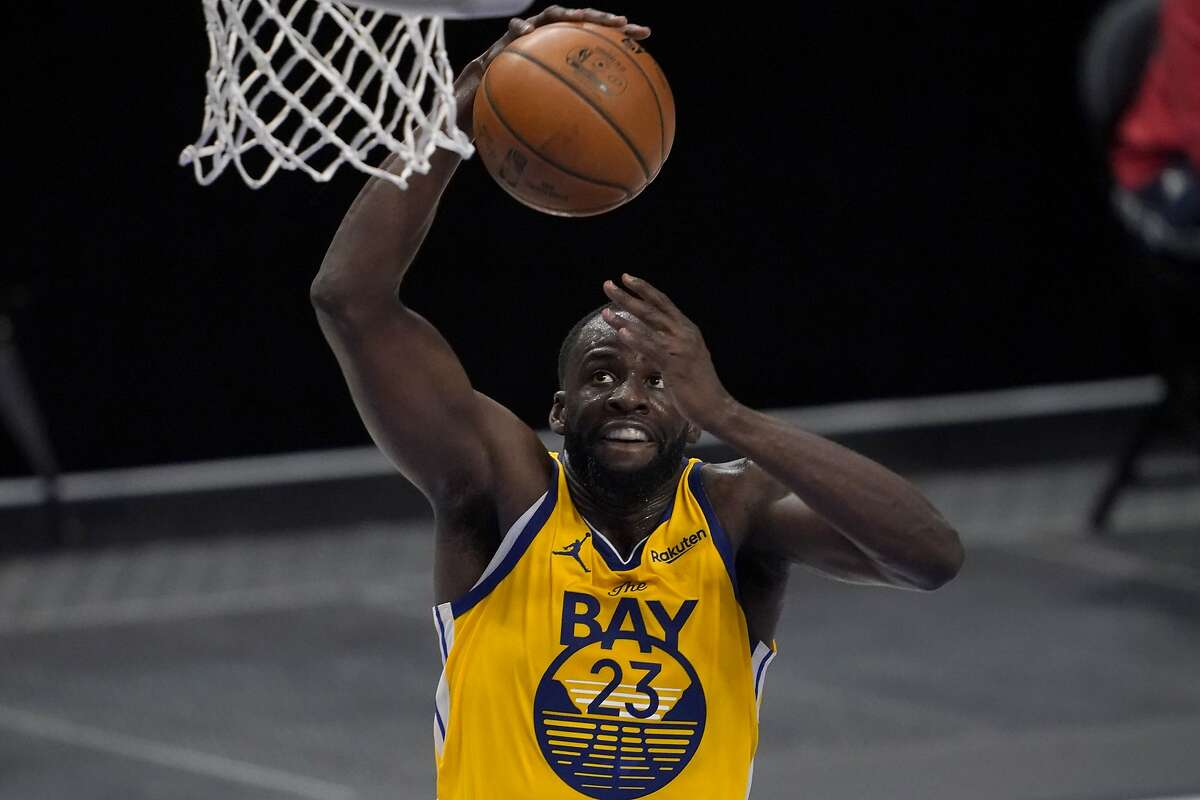 Draymond Green, here going in for a dunk, was the Warriors' starting center Thursday night and finished with 11 points, a season-high 15 assists and six rebounds.