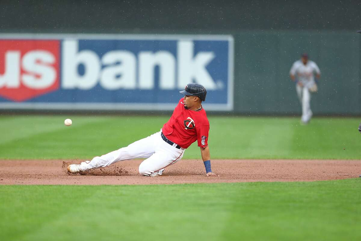 MINNEAPOLIS, MN - SEPTEMBER 07: LaMonte Wade Jr. #30 of the Minnesota Twins steals second base during the game between the Detroit Tigers and the Minnesota Twins at Target Field on Monday, September 7, 2020 in Minneapolis, Minnesota. (Photo by Harrison Barden/MLB Photos via Getty Images)