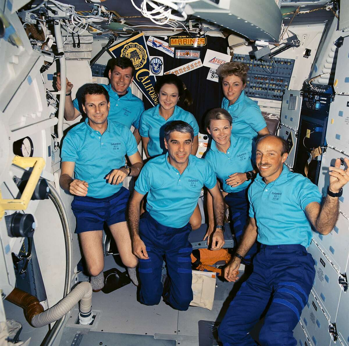 The crew of the Columbia enjoying weightlessness. Millie Hughes-Fulford is in back, to the right.