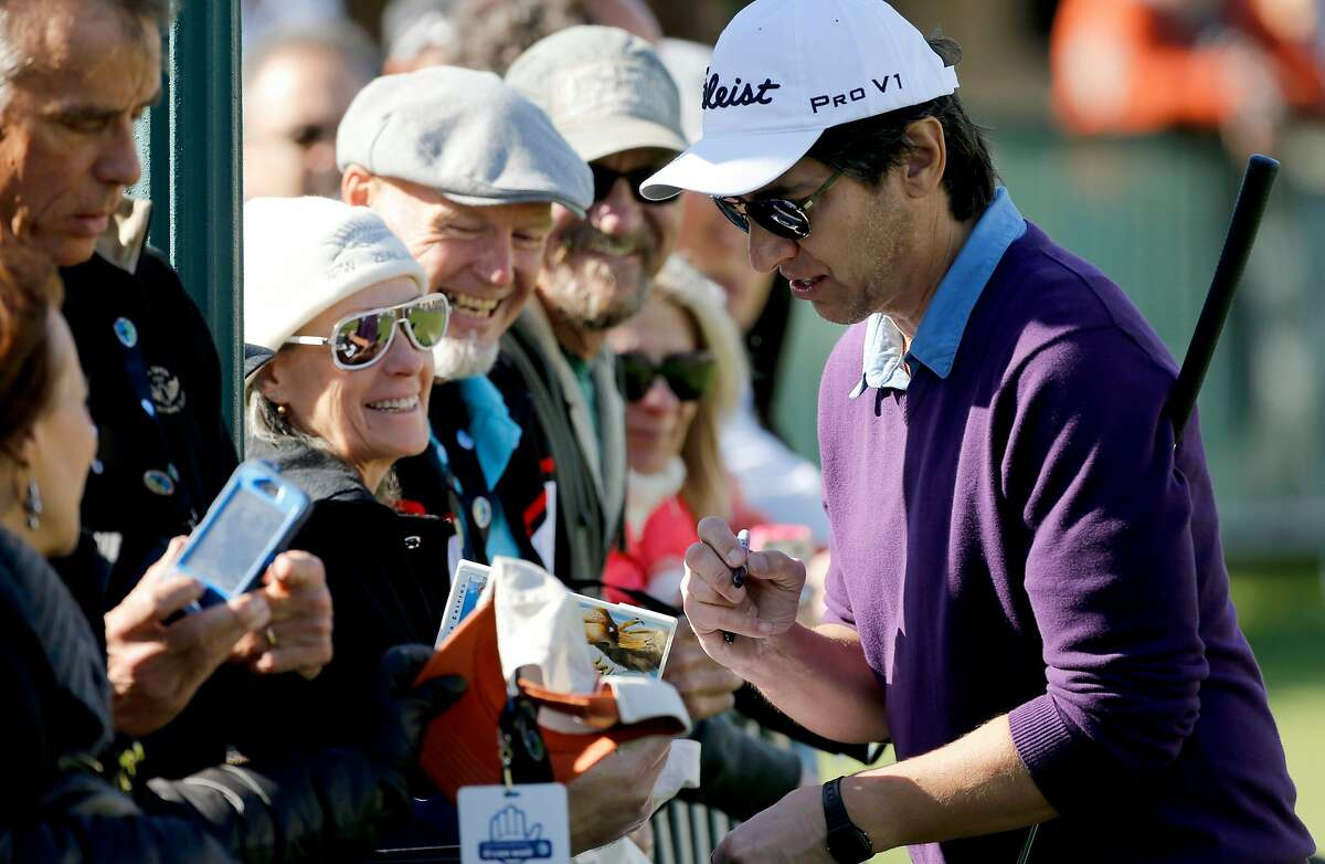 Actor Ray Romano stops to sign autographs for fans during the 3M Celebrity Challenge at Pebble Beach on Feb. 5, 2014.